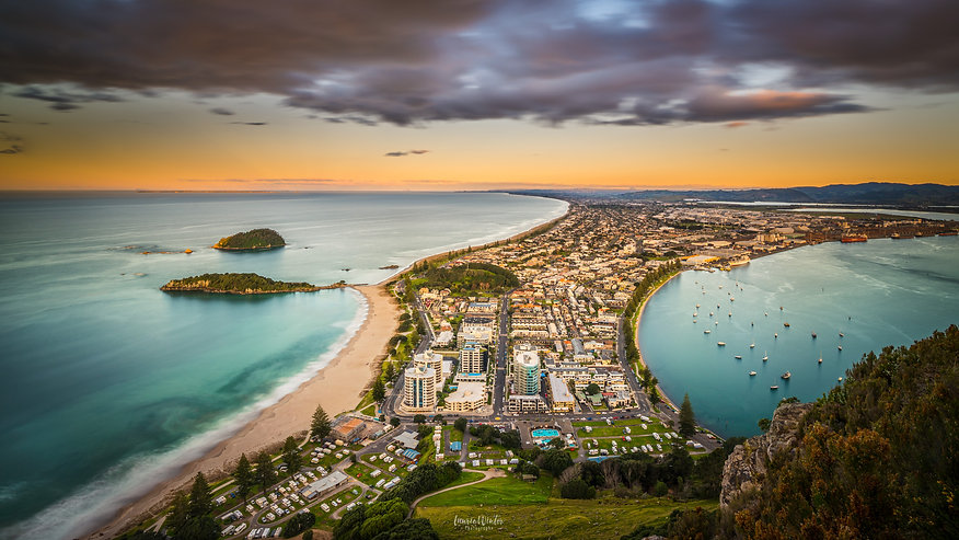 A golden sunset from the summit of Mauao Mount Maunganui in Tauranga. A beautiful location with views over the beach and Pilot Bay. New Zealand photography by Laurie Winter.