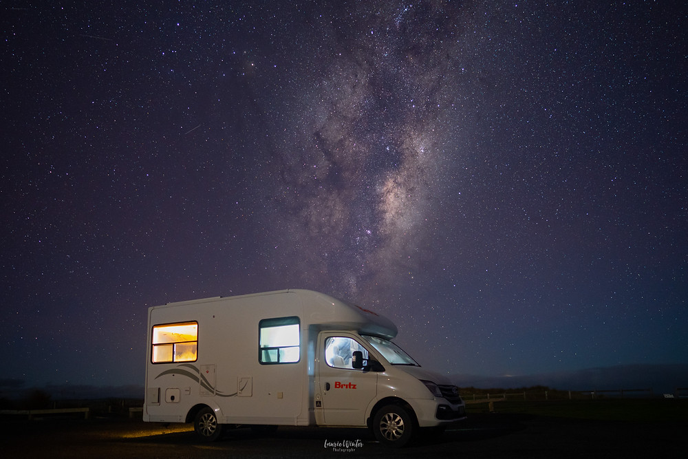 Britz campervan parked at night under the Milky Way
