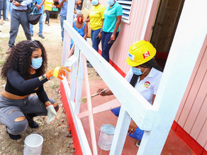 Shenseea joins Boom Energy Drink to hand over home to the needy