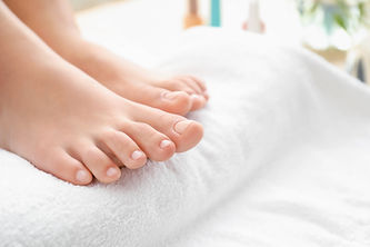 Young woman after getting professional pedicure in beauty salon, closeup.jpg