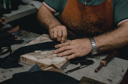 shoemaker-cutting-leather-3084342.jpg
