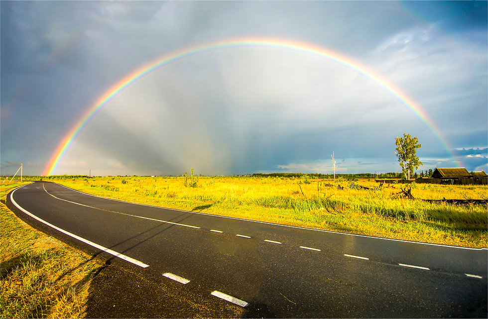 Rainbow over rural highway road spring l