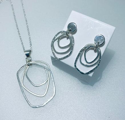 Silver earrings and pendant set