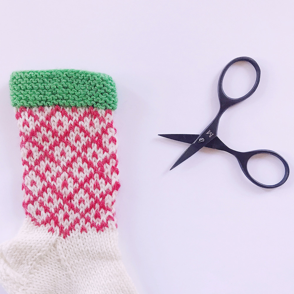 Scissors and knitted fair isle item