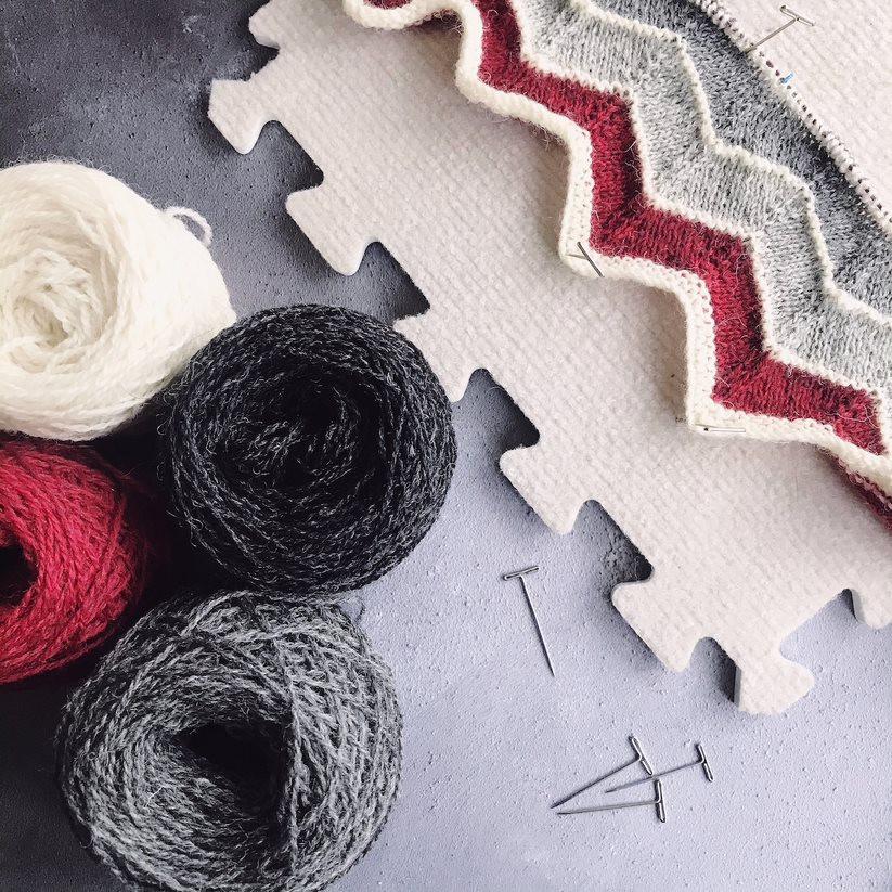 Knitting and yarn on a foam board