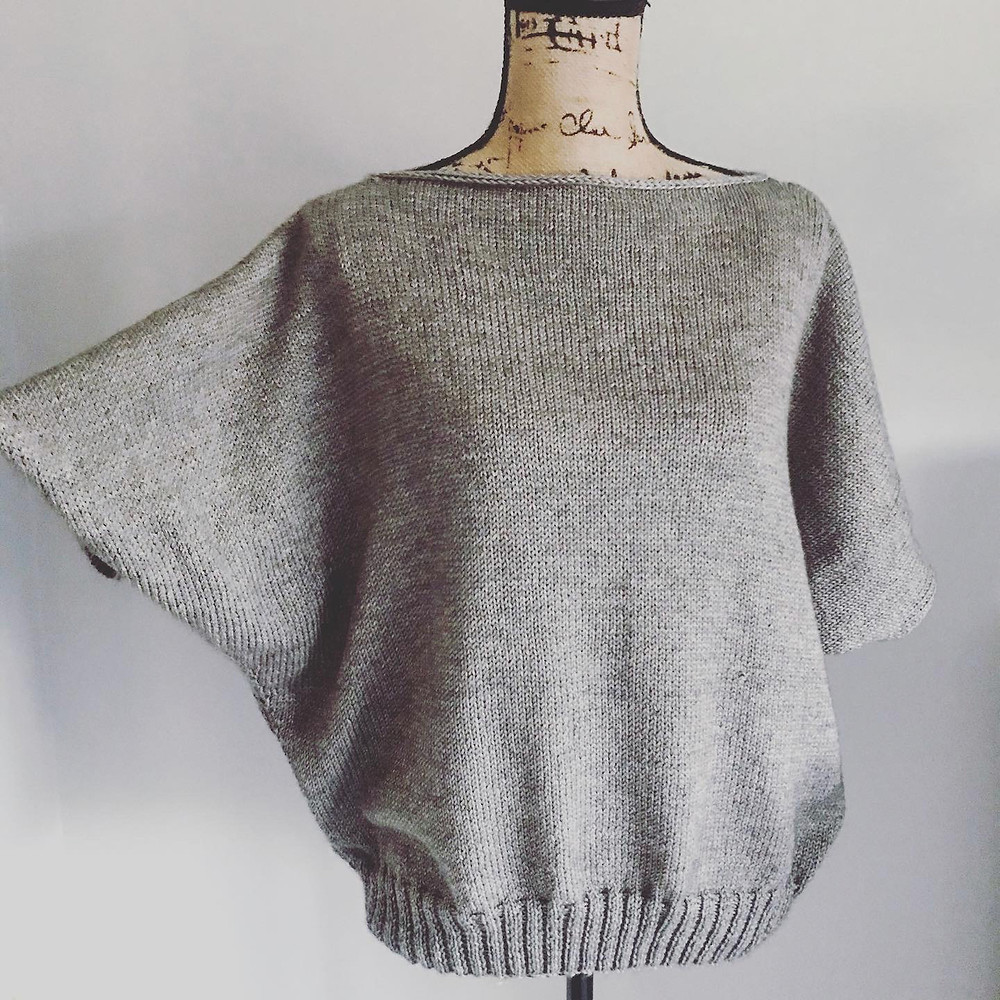 Hand knit sweater on vintage mannequin