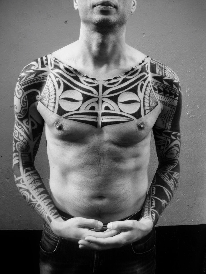 Chest and sleeves tattoo