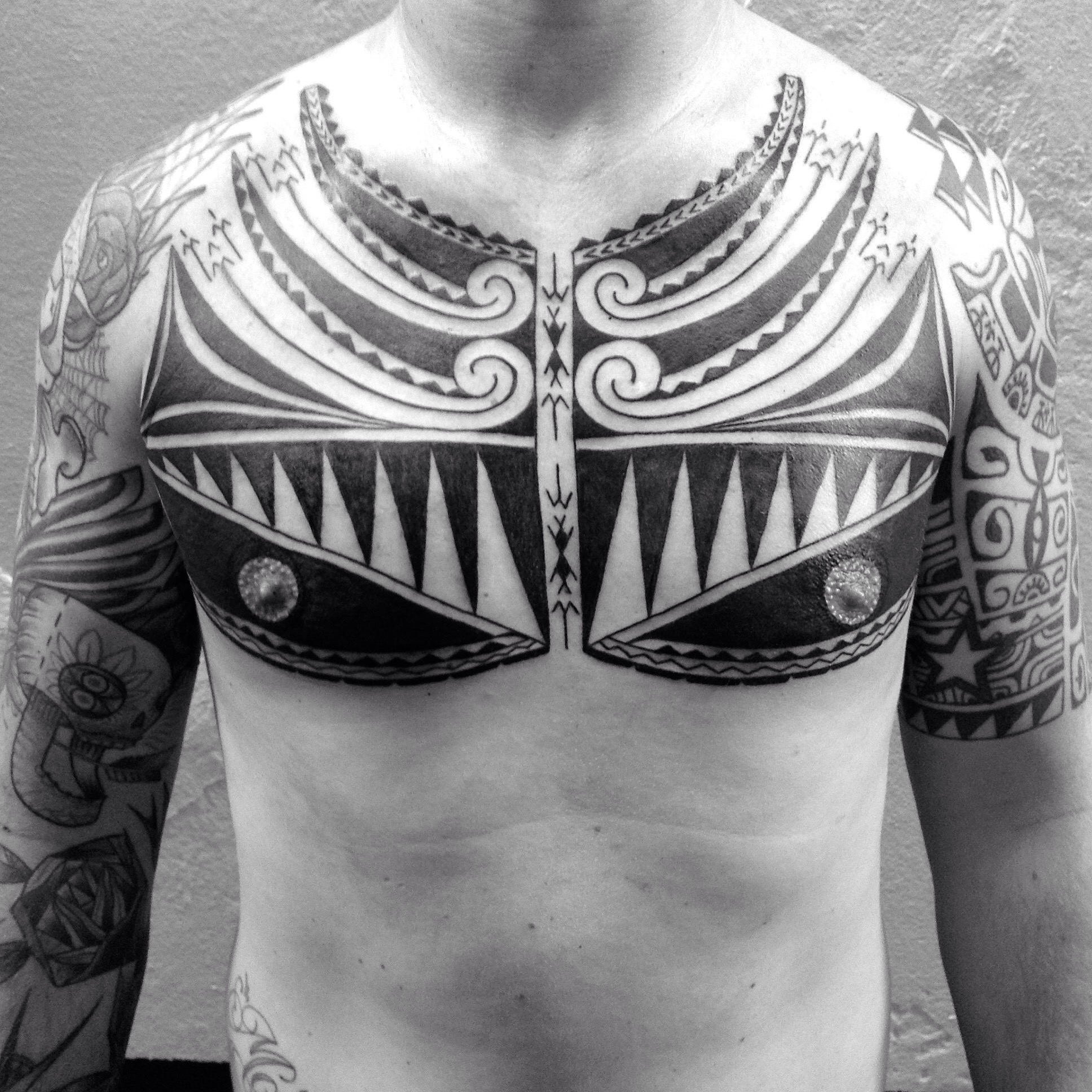 Polynesian chest tattoo