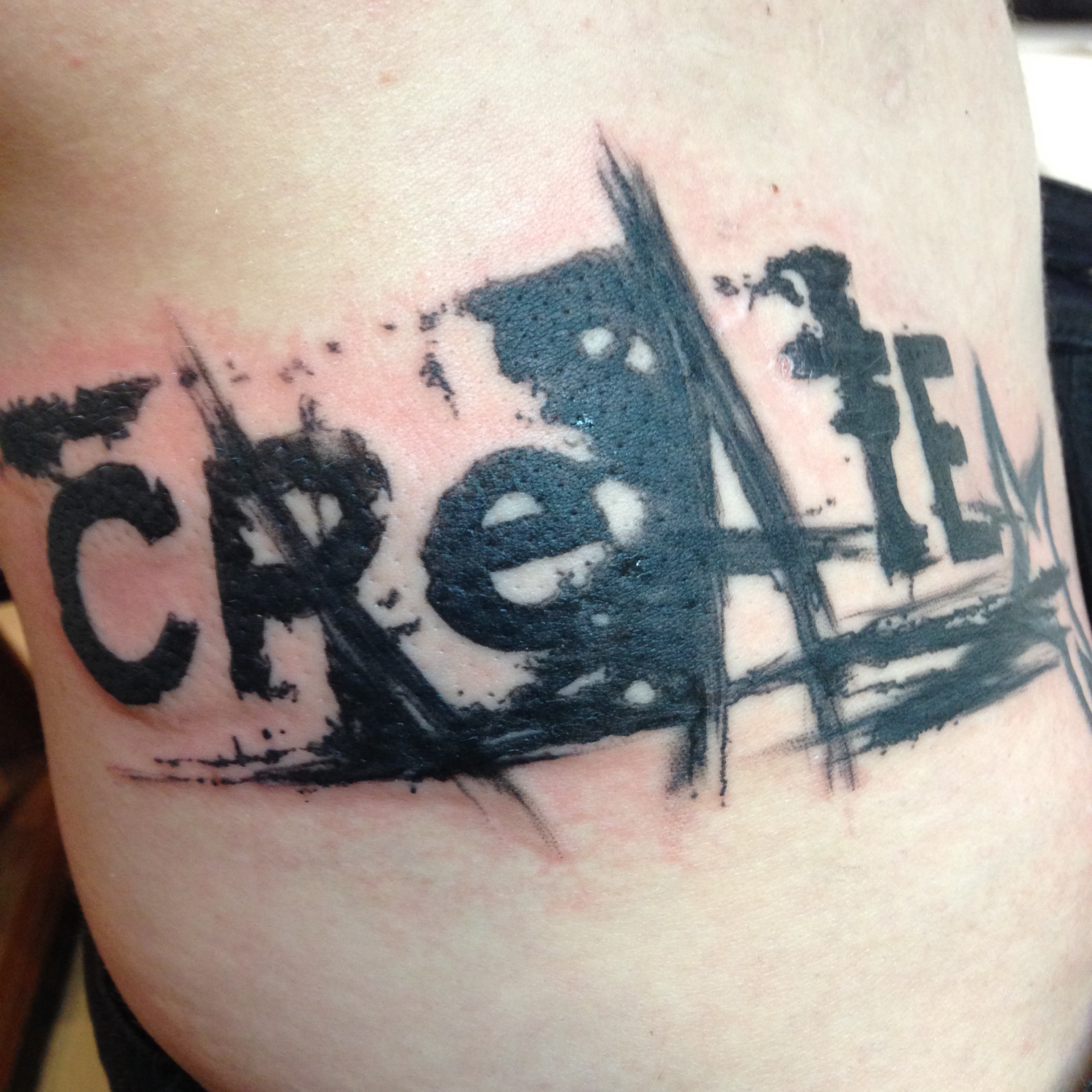 Abstract text tattoo