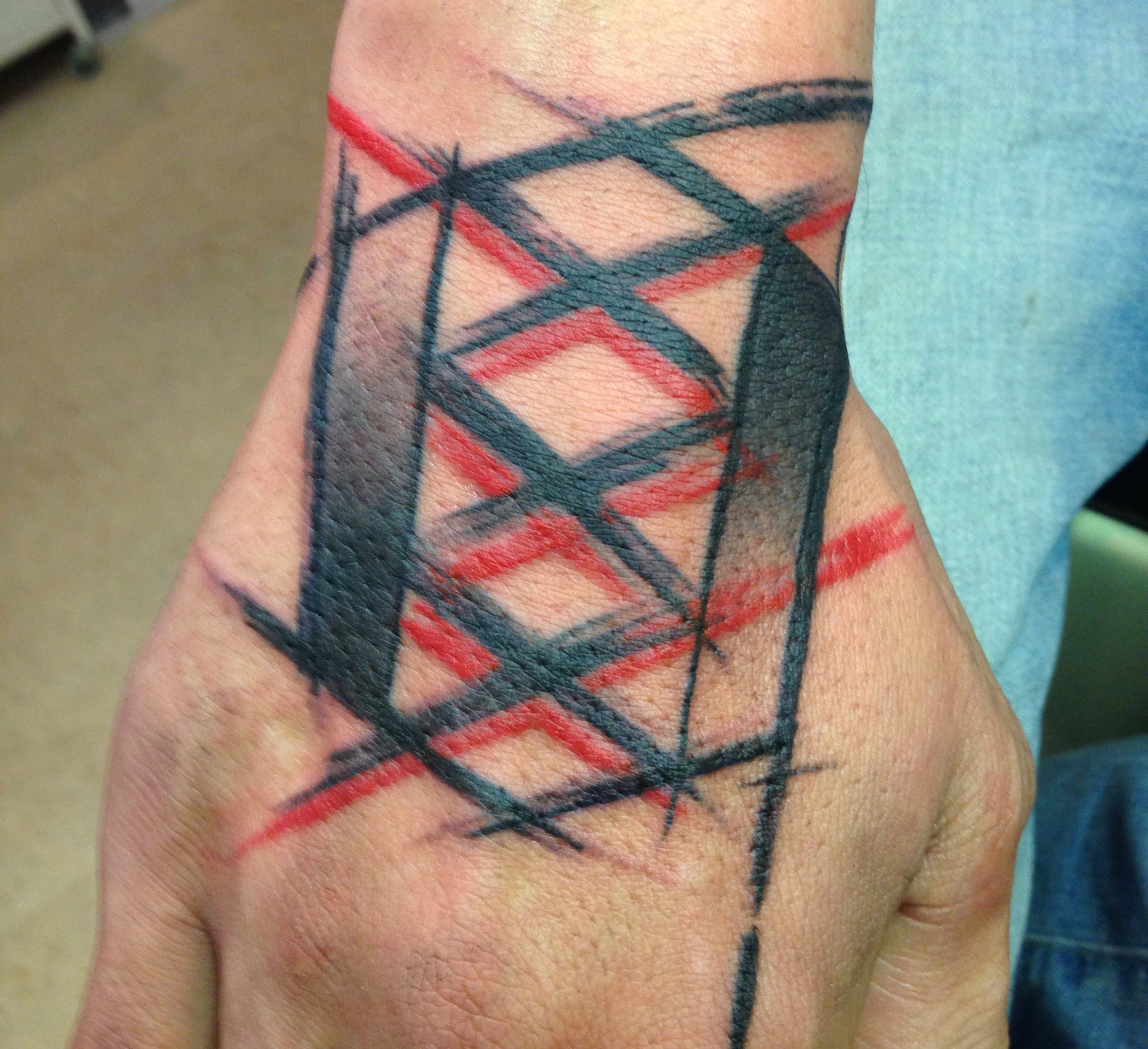 Abstract hand tattoo