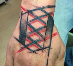 Abstract hand tattoo