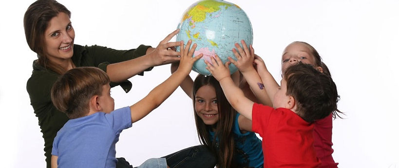 Teacher with students holding globe