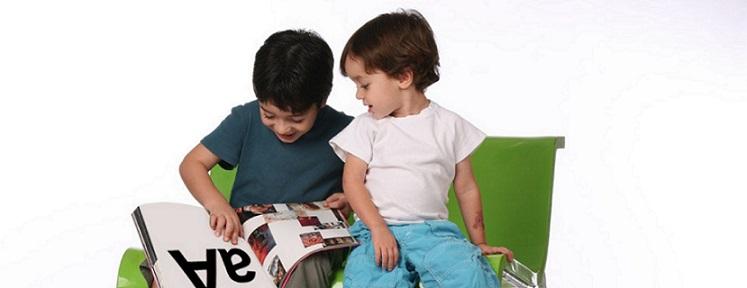 Children looking at alphabet book