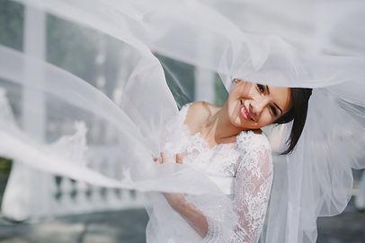 bride-smiling-through-veil.jpg