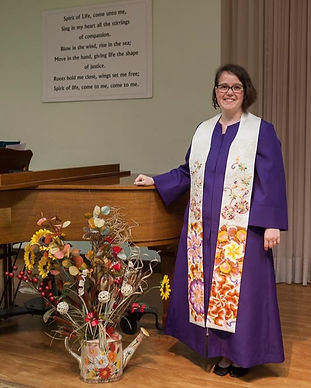 Keeping Faith Podcast, Season 2 - Episode 7 with Rev. Danielle Webber in purple robe, standing by piano and watering can filled with flowers