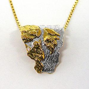 Härnösandssmycket i guld och vitguld