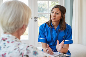 senior-woman-talking-to-young-care-nurse