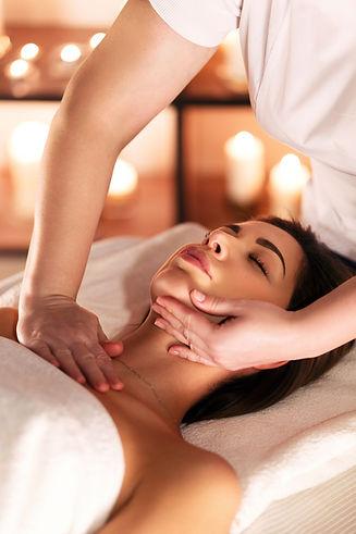 Hands of female masseuse doing a massage