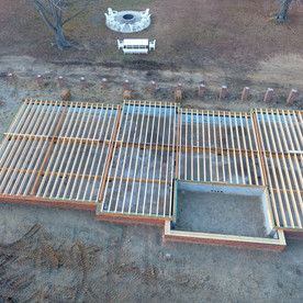 working on the foundation and floor joist system