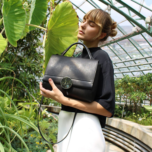 Model with black leather bag from Disselhoff