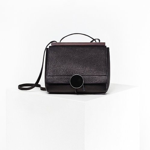 Black bio leather bag with stainless steel hardware and wood handle from Disselhoff