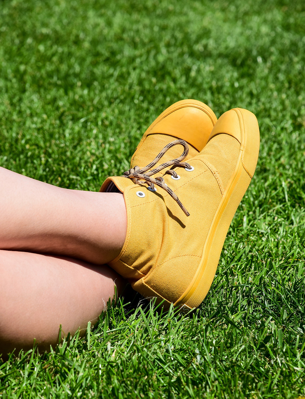picture of a person's feet wearing yellow shoes