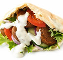 Pita bread filled with falafel, salad an