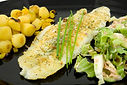 Plate with dinner_ fish, lettuce and pot