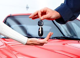 Man handing woman automobile keys.jpg
