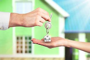 landlord handing keys to agent