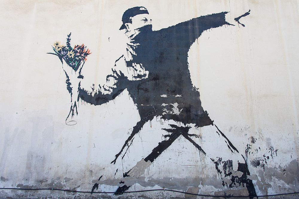 Rage, the Flower Thrower by Banksy, Jerusalem. From the8percent.com