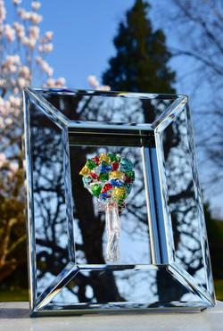bouquet on deep mirror frame