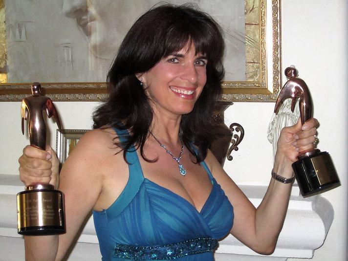 Cynthia Daddona shows her two Telly Award Wins