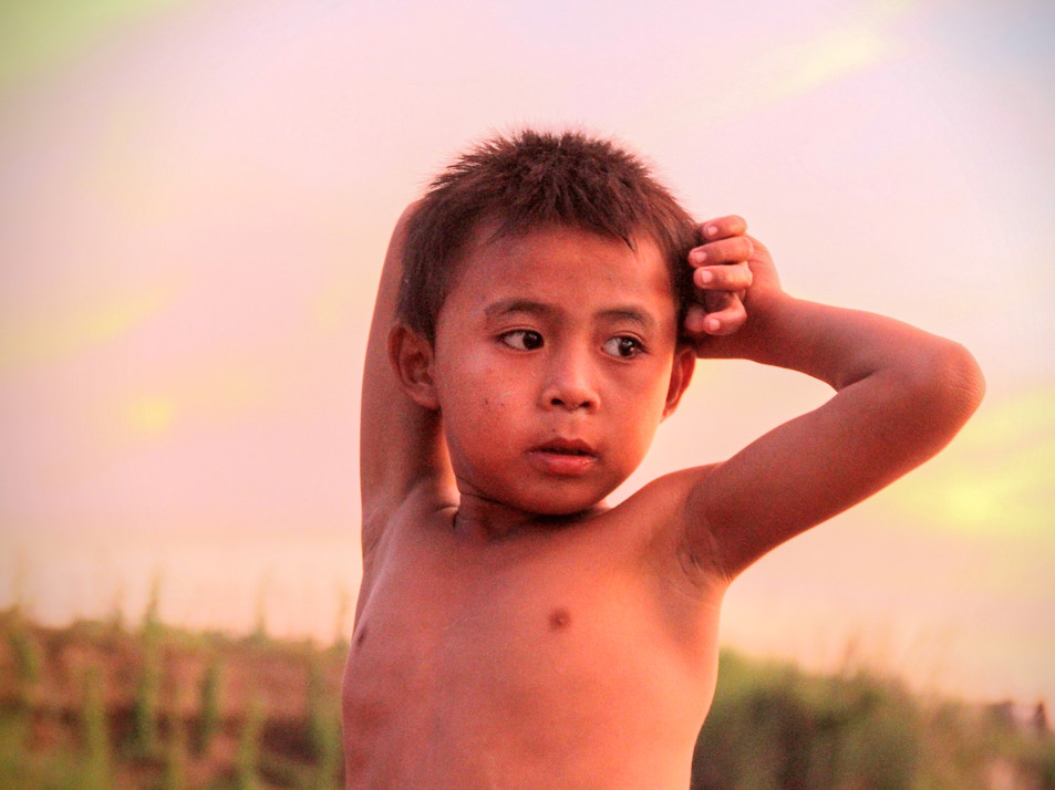 A kid in the sunset