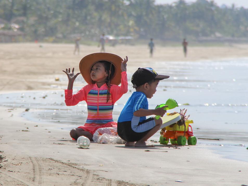 Kids playing on Ngwe Saung beach
