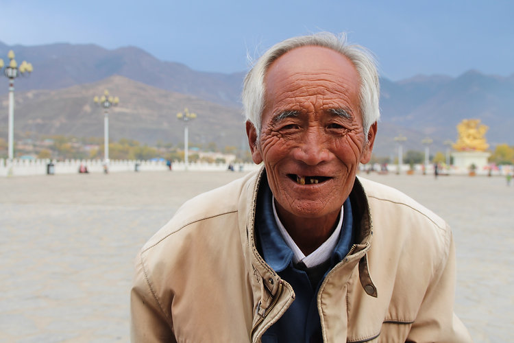 An old Tibetan man in Rebkong, China