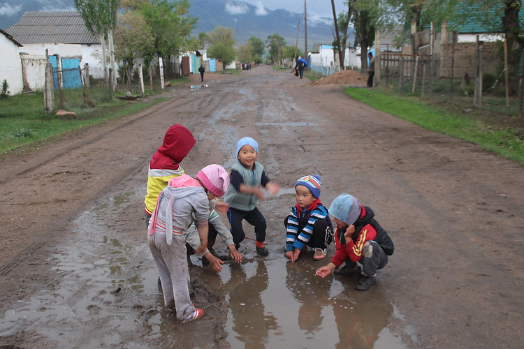 kids playing in a paddle in Kyrgyzstan