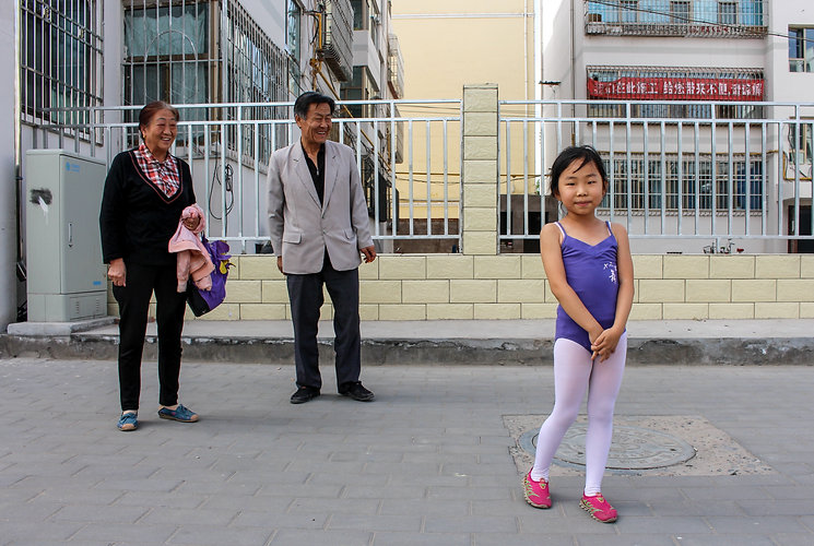 proud grandparents and their ballerina granddaughter in Zhange, China