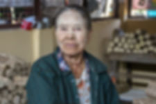 an old Burmese woman with Thanakha on her face