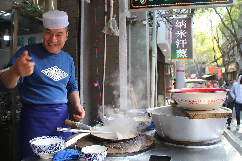 a Chinese cook in a food stall in Xi'an