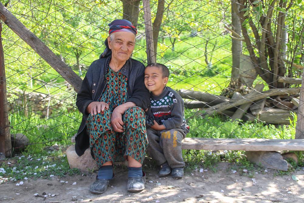 Grandmother and grandson in Sentyab village, Nurata, Uzbekistan