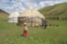 kids outside their yurt camp, kyrgzstan