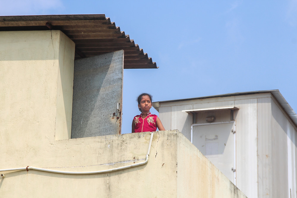 a girl on a rooftop in Thanjavur