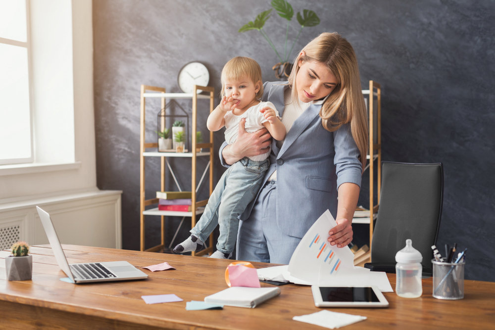 Working Mom Holding Baby.jpg
