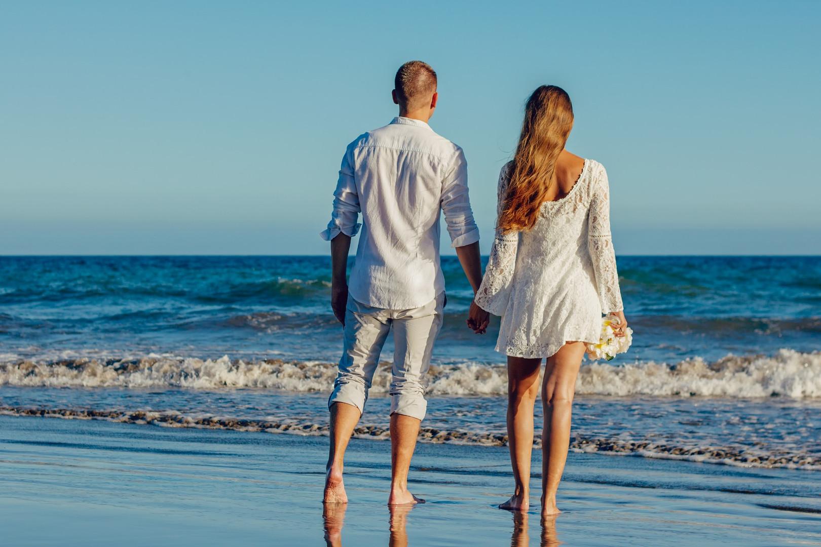 Wedding Couple Walking the Beach