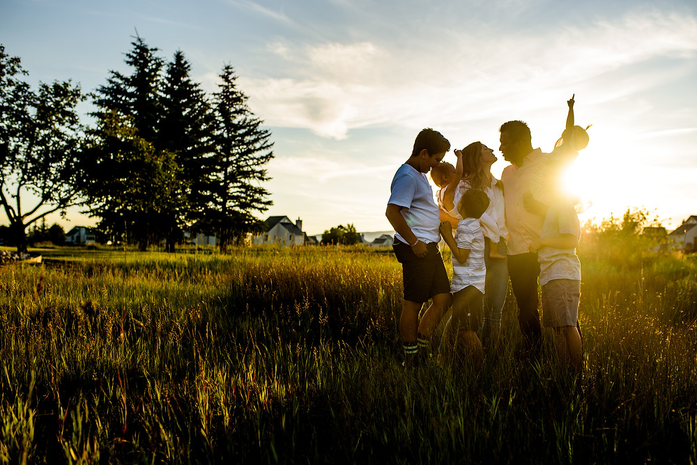 family in a field at sunset in pagosa springs