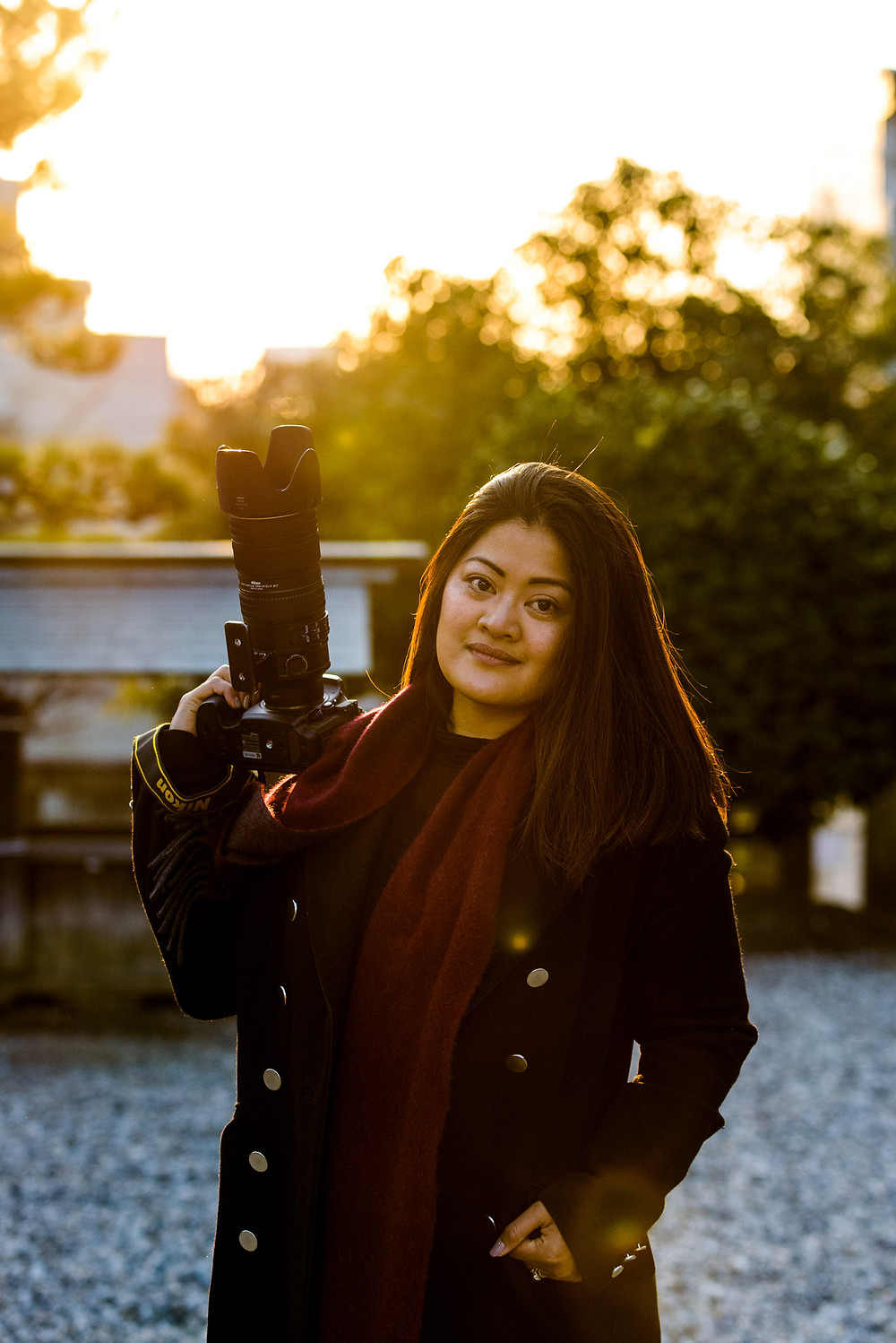 Anna Mae poses with her Camera in the sunset light