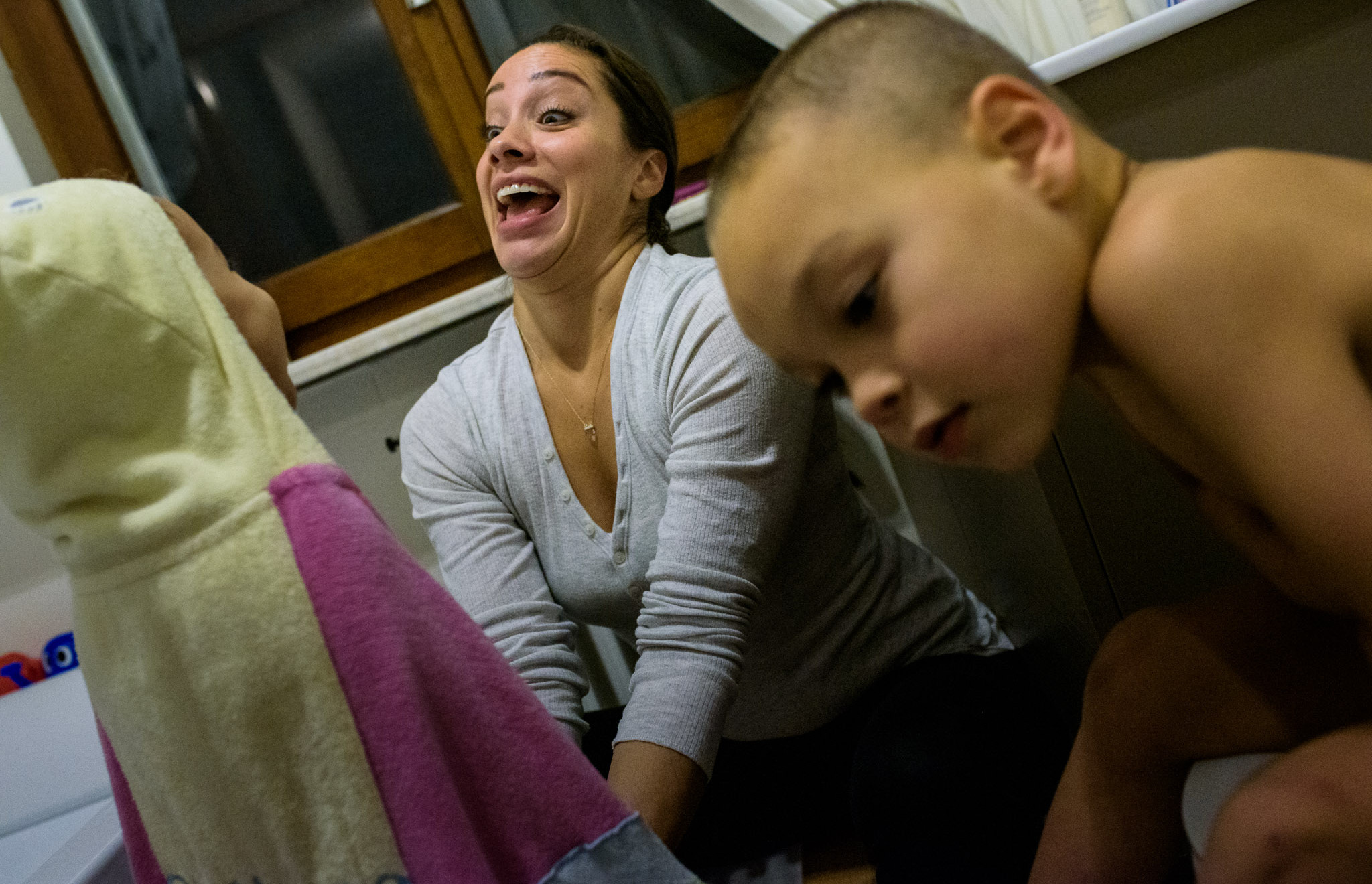 mom makes crazy face at daughter in a towel