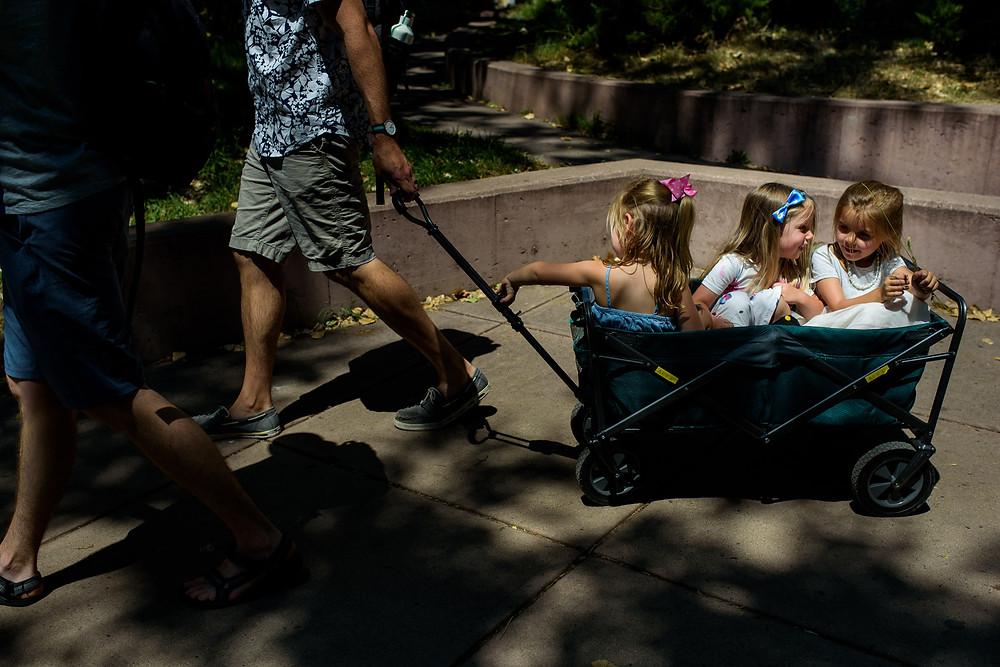 three little girls in a wagon in Golden