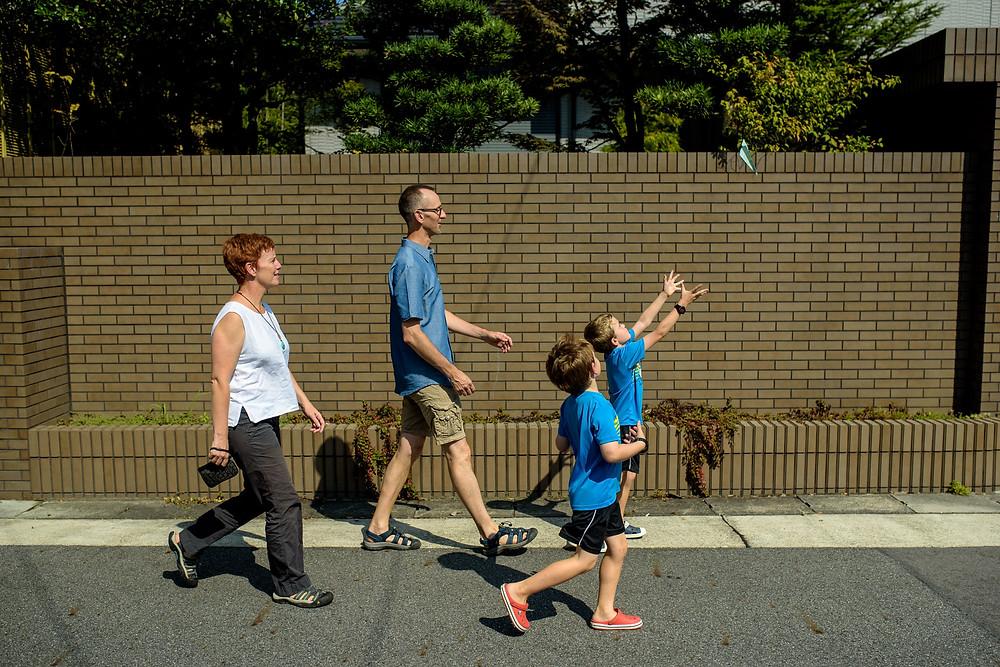 The family walks to the bakery